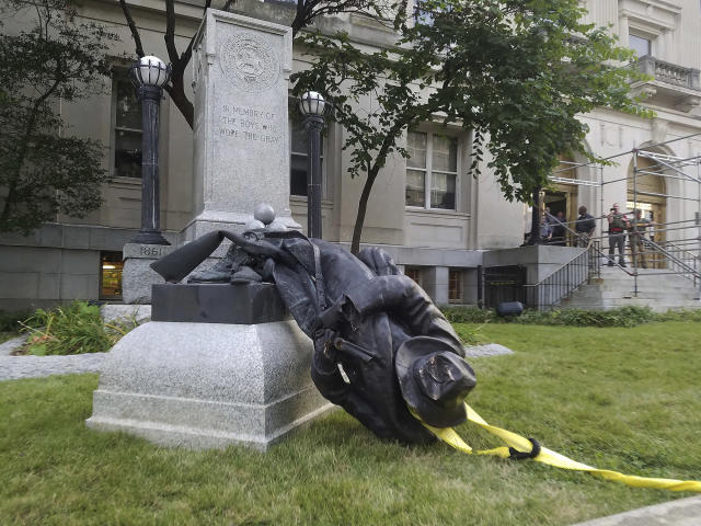 <p>A toppled Confederate statue lies on the ground on Monday, Aug. 14, 2017, in Durham, N.C. (Photo: Casey Toth/The Herald-Sun via AP) </p>