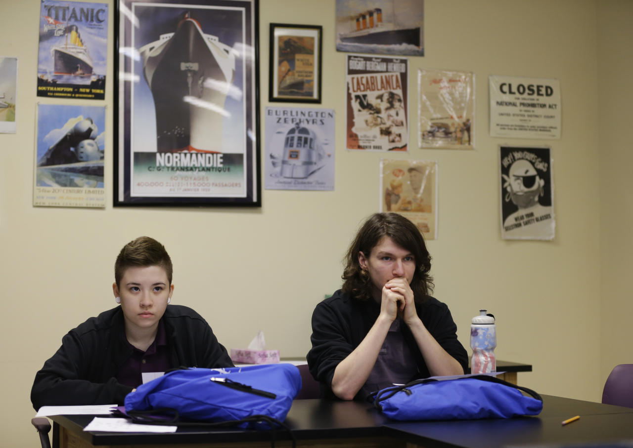 "In this Monday, March 13, 2017 photo, Aiden Thompson, left, and Lynn Feys listen during an American history class at Hope Academy in Indianapolis. Thompson, who came to Hope last year after his mom discovered his vodka and pill stash. ""Everything they said, I was like, 'That can't be true. No. No way.'"" A week later, though, he found himself talking in group meetings. Now, ""I don't even want to think about where I would be"" without the school. (AP Photo/Michael Conroy)"