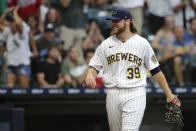 Milwaukee Brewers' Corbin Burnes reacts to a call during the fifth inning of a baseball game against the Chicago White Sox, Saturday, July 24, 2021, in Milwaukee. White Sox's Yoan Moncada was initially called safe at home but the call was changed to an out after replay review showed that he never stepped on home plate. (AP Photo/Aaron Gash)
