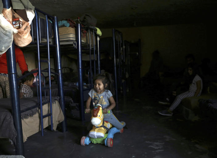 A migrant toddler plays on a ride on toy at a shelter in Ciudad Juarez, Mexico, Tuesday, March 23, 2021. Mexico announced that U.S. advisers on border and immigration issues will meet with Mexican officials on Tuesday to discuss migration and development in Central America, as a surge of migrants has hit the U.S. southern border. (AP Photo/Christian Chavez)