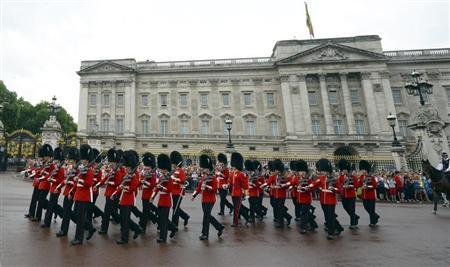 Guardsmen perform the Changing the Guard ceremony in front of Buckingham Palace, in central London
