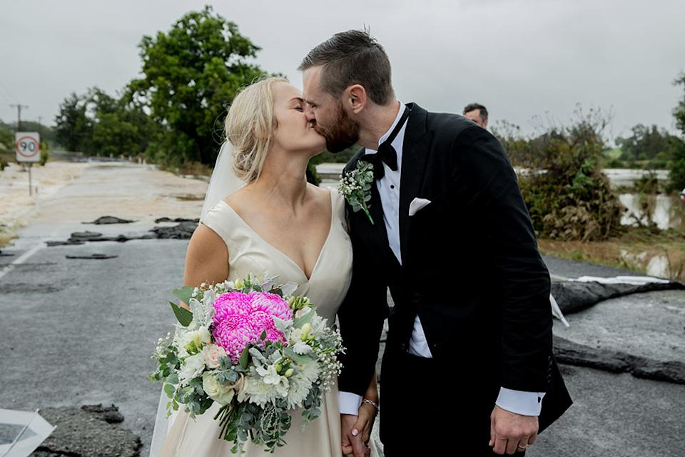 Kate Fotheringham and Wayne Bell kiss on their wedding day