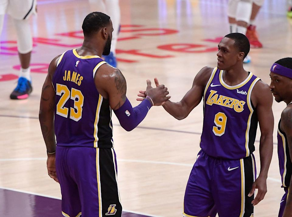 Los Angeles Lakers forward LeBron James, left, is congratulated by guard Rajon Rondo during the first half of the team's NBA basketball game against the Denver Nuggets on Wednesday, March 6, 2019, in Los Angeles. With the basket, James moved past Michael Jordan for fourth place on the NBA career scoring list. (AP Photo/Mark J. Terrill)