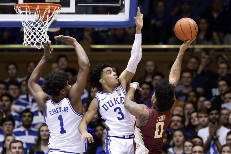 Duke center Vernon Carey Jr. (1) and guard Tre Jones (3) defend against Florida State guard Rayquan Evans (0) during the second half of an NCAA college basketball game in Durham, N.C., Monday, Feb. 10, 2020. (AP Photo/Gerry Broome)