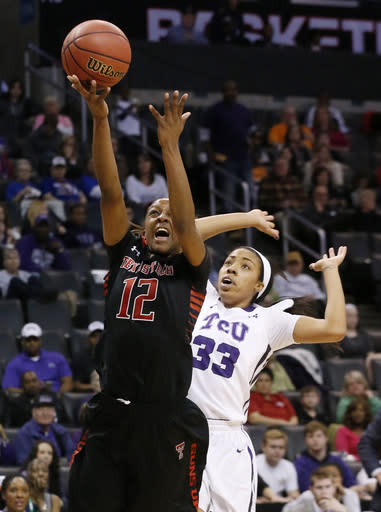Texas Tech guard Amber Battle (12) shoots in front of TCU guard Donielle Breaux (33) in the first half of a Big 12 women's NCAA college basketball tournament game in Oklahoma City, Friday, March 7, 2014. (AP Photo/Sue Ogrocki)