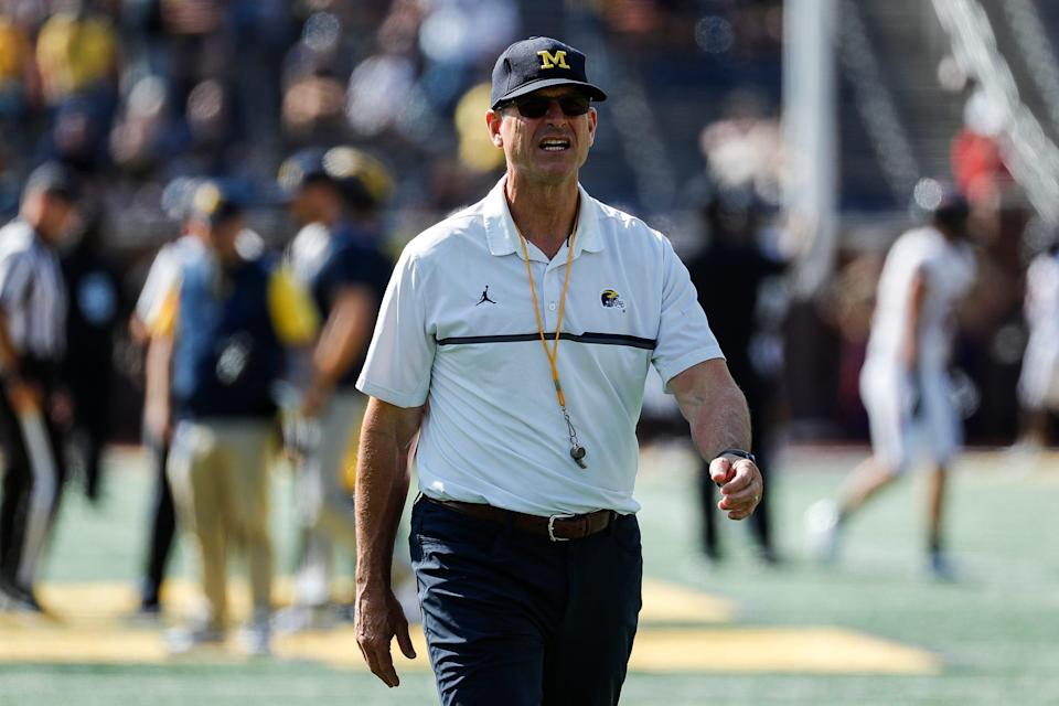 Michigan head coach Jim Harbaugh watches warmups before a game against Northern Illinois at Michigan Stadium in Ann Arbor on Saturday, Sept. 18, 2021.