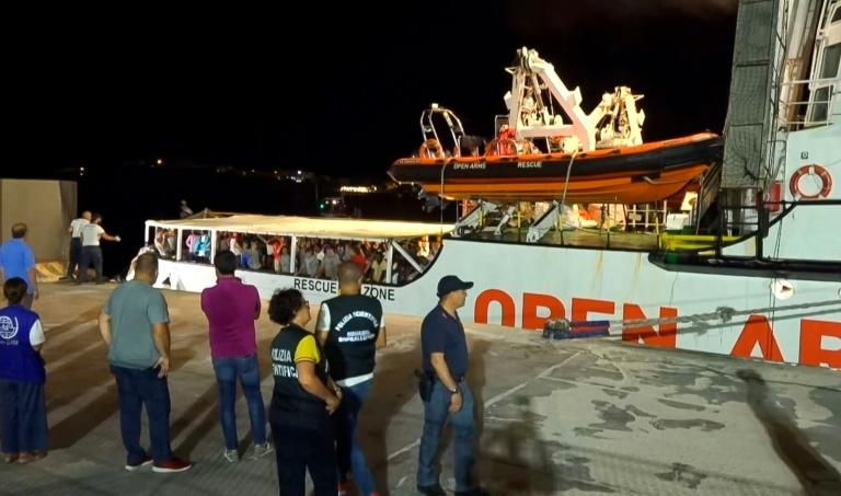 The Open Arms boat had spent six days anchored off Lampedusa before a local prosecutor ordered the migrants be allowed to land