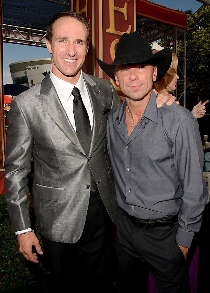 New Orleans Saints quarterback Drew Brees and country music star Kenny Chesney arrive at the 2012 ESPY Awards.