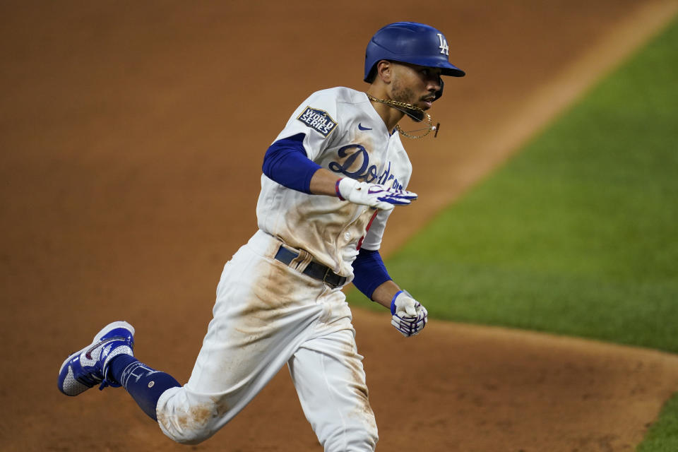 Mookie Betts helped the Dodgers win Game 1 at the plate and on the basepaths. (Photo by Cooper Neill/MLB Photos via Getty Images)