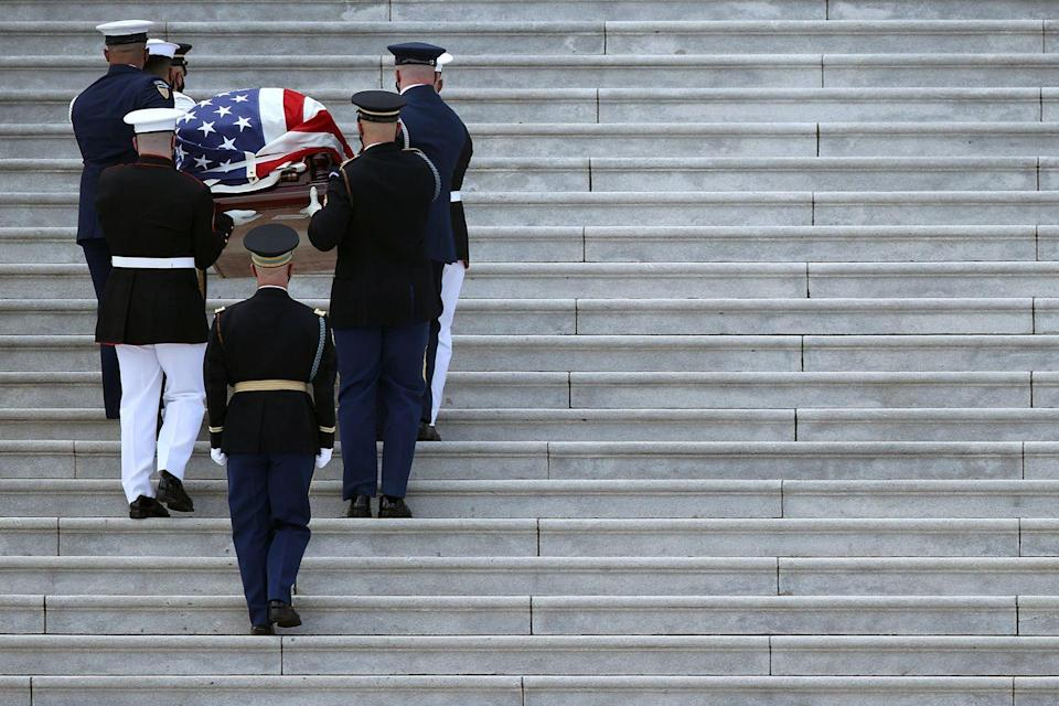 <p>A military honor guard carries the flag-draped casket of Rep. John Lewis (D-GA) into the U.S. Capitol where he will lie in state July 27, 2020 in Washington, DC.</p>