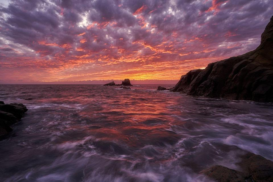 <p>A high tide and intense sunset collide in Crescent Bay, Laguna Beach, California //2019</p>