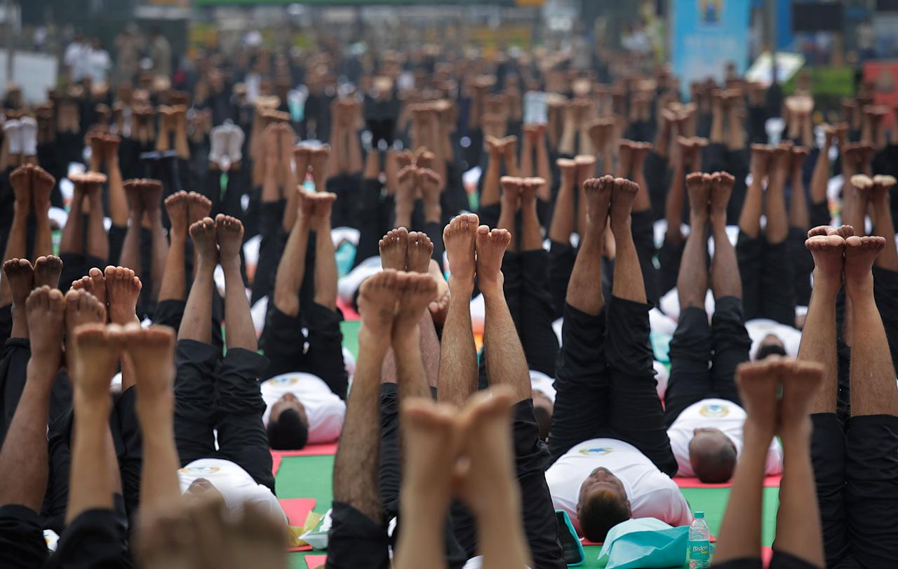 <p>Indians perform Yoga to mark the International Yoga Day in New Delhi, India, Wednesday, June 21, 2017. (Photo: Manish Swarup/AP) </p>