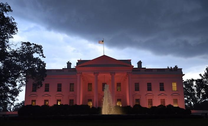 The White House is lit in pink in honor of breast cancer awareness month on Oct. 9.
