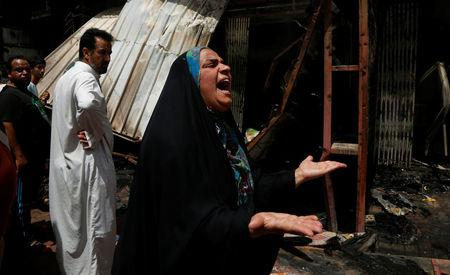 A woman reacts at the scene of a car bomb attack in Baghdad's mainly Shi'ite district of Sadr City, Iraq, May 11, 2016. REUTERS/Wissm al-Okili