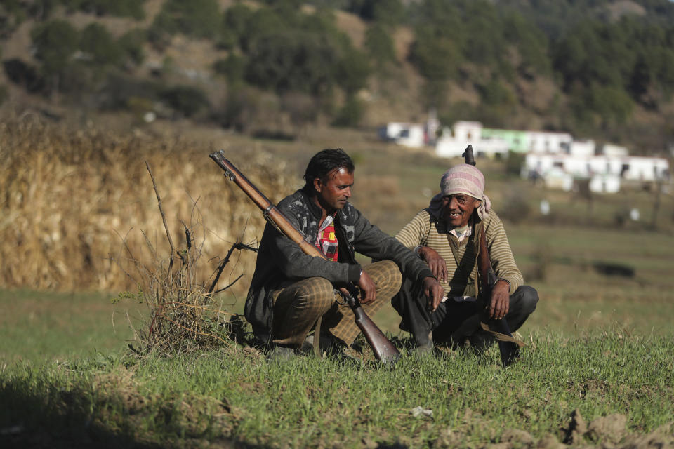 Members of a local militia called Village Defense Committees, that have been formed to aid the Indian army in keeping a close watch of the India-Pakistan border, rest near the Line of Control, at Jhangad Village in Naushera, India, Thursday, Dec. 17, 2020. From sandbagged Indian army bunkers dug deep into the Pir Panjal mountains in the Himalayas, villages on the Pakistan-controlled side of Kashmir appear precariously close, on the other side of the Line of Control that for the past 73 years has divided the region between the two nuclear-armed rivals. Tens of thousands of soldiers from India and Pakistan are positioned along the two sides. The apparent calm is often broken by the boom of blazing guns, with each side accusing the other of initiating the firing. (AP Photo/Channi Anand)