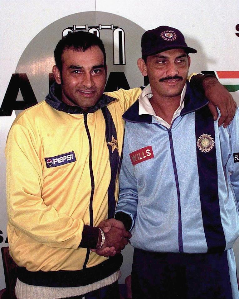 TORONTO, CANADA:  Aamir Sohail (L), captain of the Pakistani side and Mohammad Azharuddin (R), captain of the Indian side, pose 11 September with each other at the end of a press conference before the start of the Sahara Cup Cricket tournament in Toronto, Canada. India and Pakistan play a friendly tournament over the next 10 days.    (ELECTRONIC IMAGE)    AFP PHOTO    Carlo ALLEGRI (Photo credit should read CARLO ALLEGRI/AFP/Getty Images)