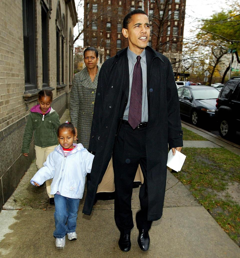 Then-Illinois Democratic Senate candidate Barack Obama leaves with his wife Michelle, daughters Sasha, front left, and Malia after voting at Catholic Theological union polling place in Chicago on Nov. 2, 2004.