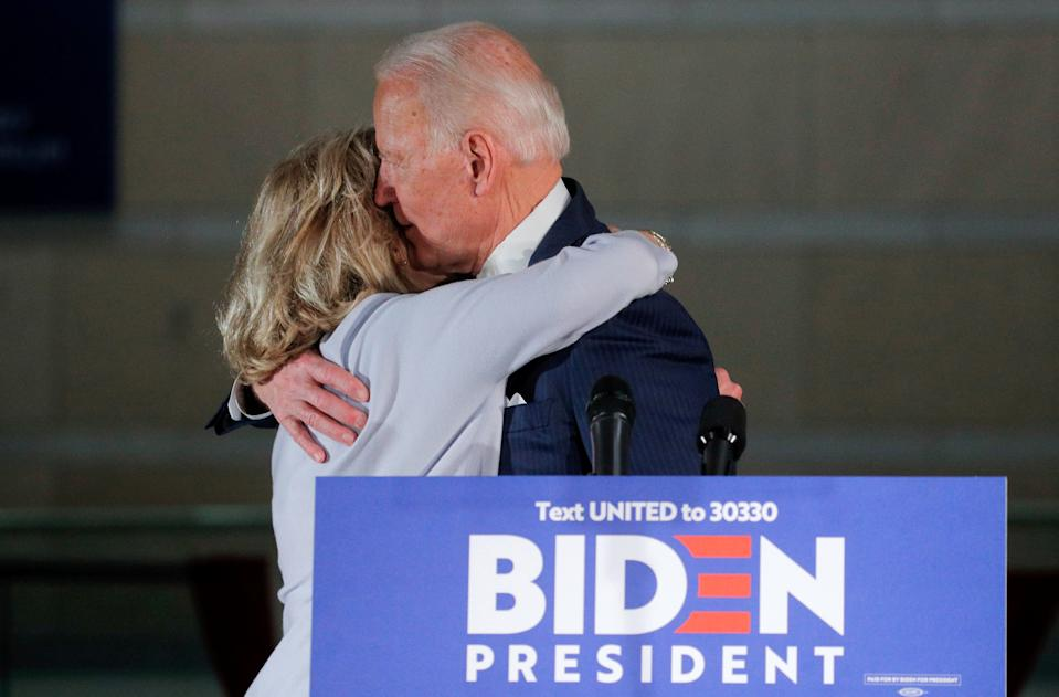 Democratic U.S. presidential candidate and former Vice President Joe Biden hugs his wife Jill after a primary night speech at The National Constitution Center in Philadelphia, Pennsylvania, U.S., March 10, 2020. REUTERS/Brendan McDermid     TPX IMAGES OF THE DAY