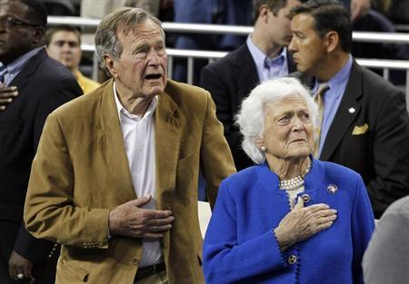 Former U.S. President Bush and his wife, Barbara, stand during the national anthem before men's final NCAA Final Four college basketball championship game in Houston
