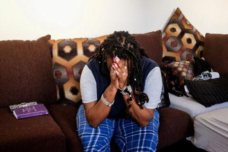 U.S. federal government contractor Yvette Hicks, whose status as a contractor means that she will receive no back pay from the 35 day partial U.S. government shutdown, cries in frustration as she talks about her situation at her home in Washington, U.S. January 25, 2019. REUTERS/Michael A. McCoy