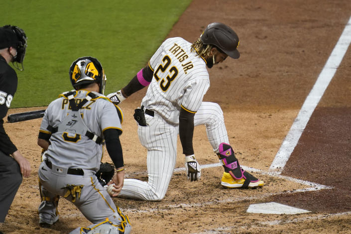 San Diego Padres' Fernando Tatis Jr. strikes out while batting as Pittsburgh Pirates catcher Michael Perez looks on, left, during the sixth inning of a baseball game Monday, May 3, 2021, in San Diego. (AP Photo/Gregory Bull)