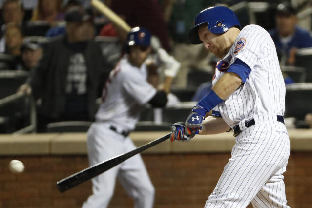 New York Mets' Todd Frazier connects on a second-inning, two-run double in the team's baseball game against the Arizona Diamondbacks, Tuesday, Sept. 10, 2019, in New York. (AP Photo/Kathy Willens)