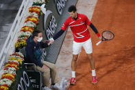 Serbia's Novak Djokovic checks on a linesman after a ball spun off his racket in the fourth round match of the French Open tennis tournament against Russia's Karen Khachanov at the Roland Garros stadium in Paris, France, Monday, Oct. 5, 2020. (AP Photo/Christophe Ena)
