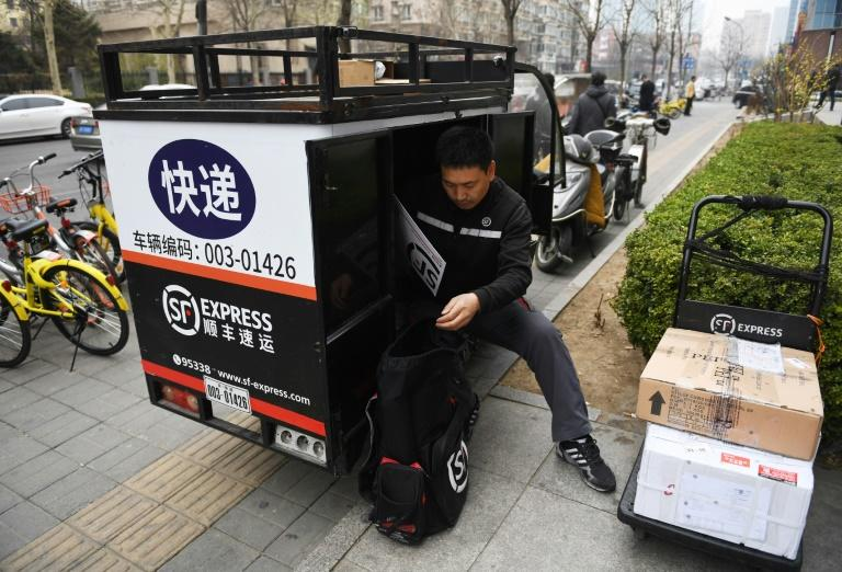 SF Express has an 80,000-strong staff -- using three-dozen aircraft and thousands of vehicles -- delivering throughout China's huge cities