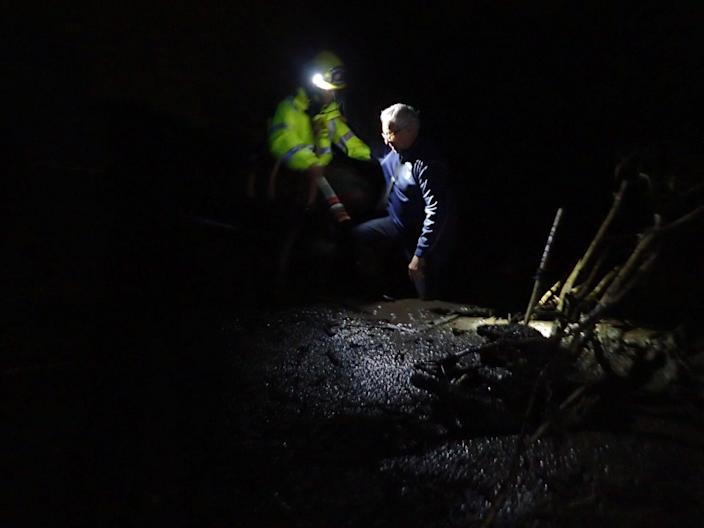 <p>Emergency personnel rescue a man from flood waters and debris after a mudslide in Montecito, Calif., on Jan. 9, 2018. (Photo: Santa Barbara County Fire Department/Handout via Reuters) </p>