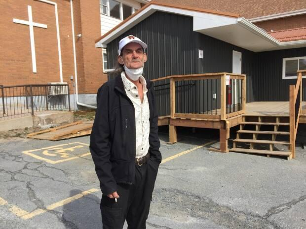 Snake said he's proud to have helped build Freedom Kitchen's new building outside Knox United Church. (Elizabeth Chiu/CBC - image credit)