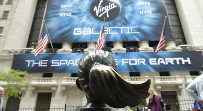 Virgin Galactic (SPCE) billboard on the New York Stock Exchange, across from the Fearless Girl statue. aerospace stocks