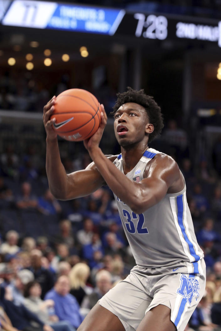 Memphis' James Wiseman (32) shoots a basket during the second half of an NCAA college basketball game against Illinois-Chicago, Friday, Nov. 8, 2019, in Memphis, Tenn. (AP Photo/Karen Pulfer Focht)