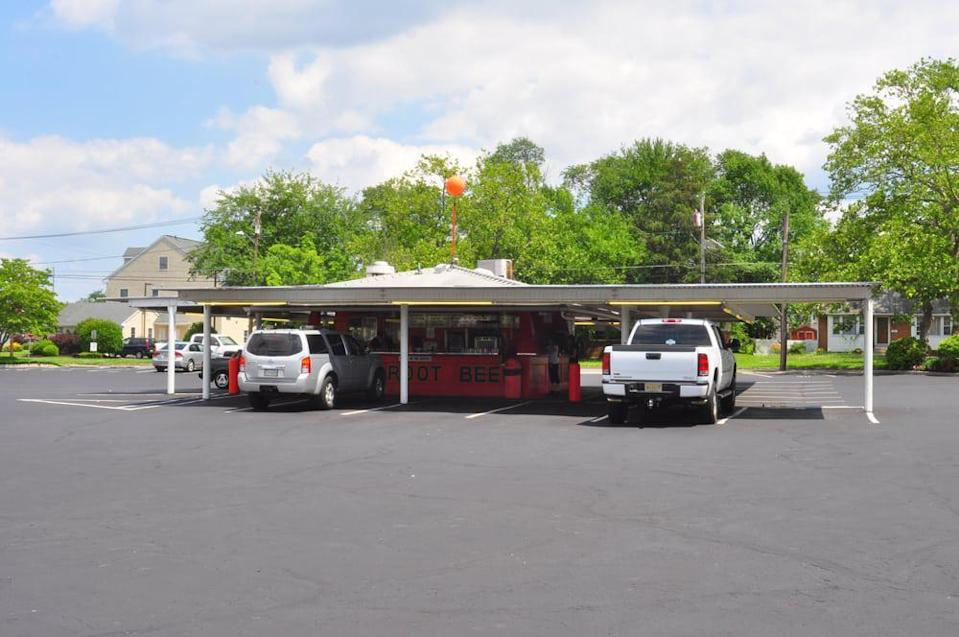"""<p>You'll spot Weber's Drive In in Pennsauken, New Jersey by its bright orange building and a metal canopy covering the automobiles that pull up for some carside service. The root beer is the go-to menu item; it's made from an old-school recipe and is so popular that Weber's sells it in gallons for takeaway. As for the food, well, dig in to a pork roll and cheese sandwich. It's a <a href=""""https://www.thedailymeal.com/cook/regional-breakfast-foods?referrer=yahoo&category=beauty_food&include_utm=1&utm_medium=referral&utm_source=yahoo&utm_campaign=feed"""" rel=""""nofollow noopener"""" target=""""_blank"""" data-ylk=""""slk:regional breakfast dish you need to try"""" class=""""link rapid-noclick-resp"""">regional breakfast dish you need to try</a>.</p>"""