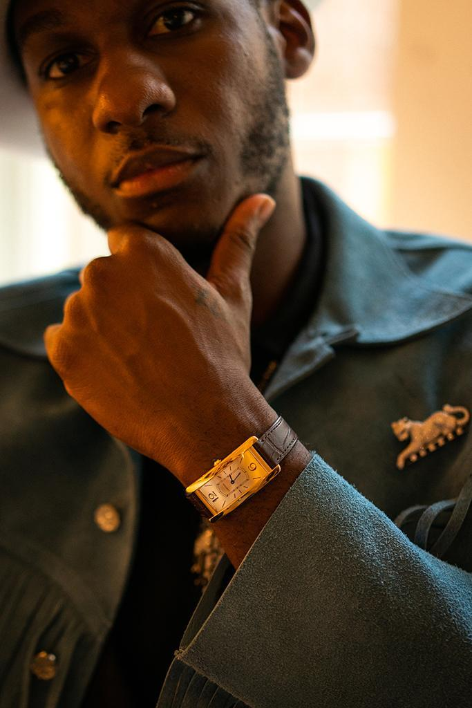 Léon Bridges wearing a Cartier watch and jewelry.  - Credit: Courtesy of Eric Lagg