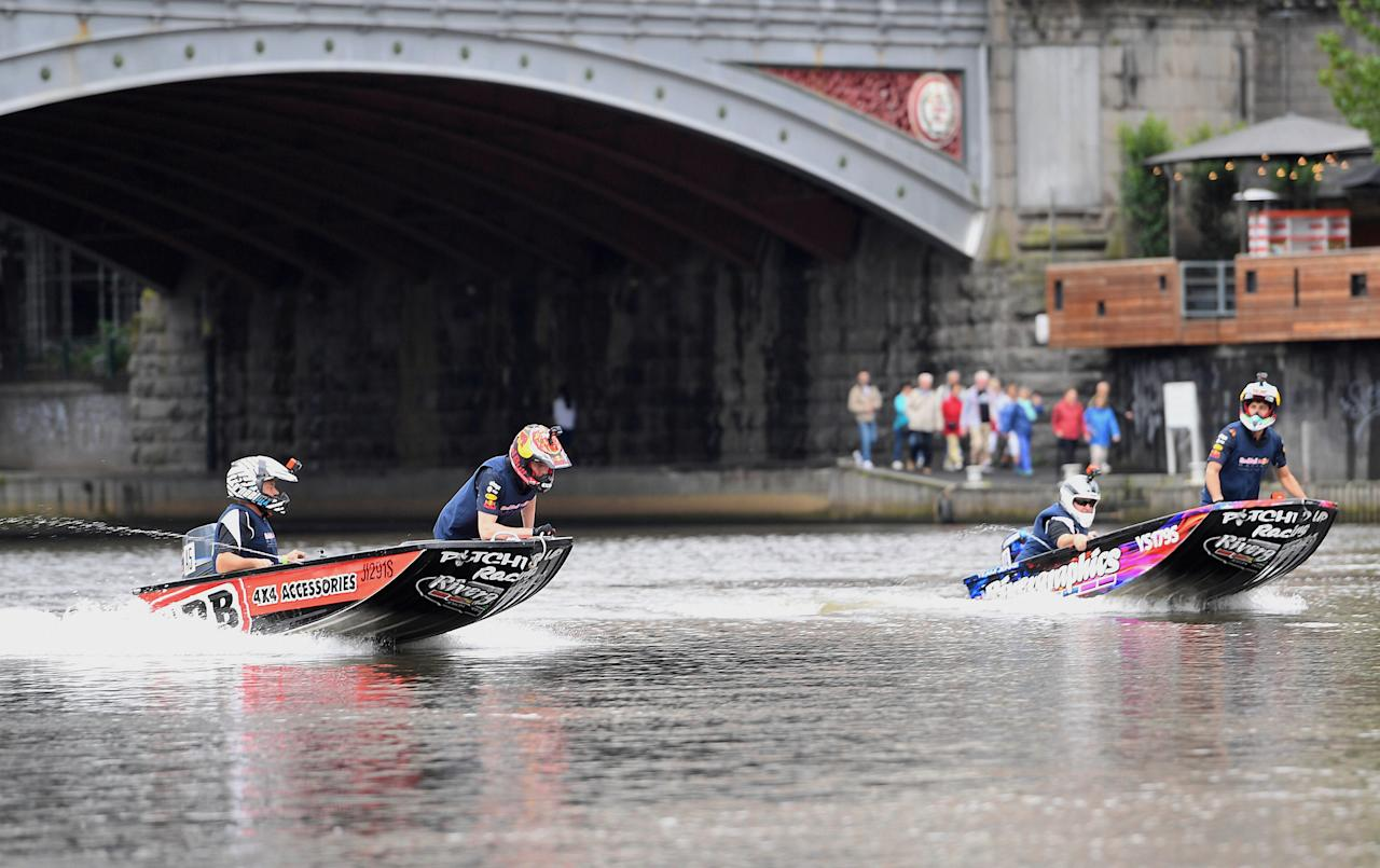 Australian Formula One driver Daniel Ricciardo (R) and his Red Bull teammate Max Verstappen from The Netherlands race speedboats on the Yarra River during a promotional event in Melbourne, Australia, March 22, 2017.    AAP/Tracey Nearmy/via REUTERS    ATTENTION EDITORS - THIS IMAGE WAS PROVIDED BY A THIRD PARTY. EDITORIAL USE ONLY. NO RESALES. NO ARCHIVE. AUSTRALIA OUT. NEW ZEALAND OUT.