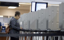 A lone voter fills out a ballot in the lobby of the Denver Elections Division early Tuesday, Nov. 5, 2019, in downtown Denver. (AP Photo/David Zalubowski)