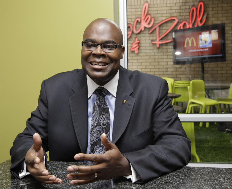 FILE - In this June 10, 2010 file photo, McDonald's President Don Thompson, gestures during an interview with The Associated Press at the presentation of the World Cup player escorts sponsorship program, at the Rock'n Roll McDonald's in Sandton, Johannesburg, South Africa. McDonald's on Wednesday, March 21, 2012 said CEO Jim Skinner will retire later this year. Thompson, 48, will take over the helm of the world's biggest hamburger chain on July 1.  (AP Photo/Yves Logghe, File)