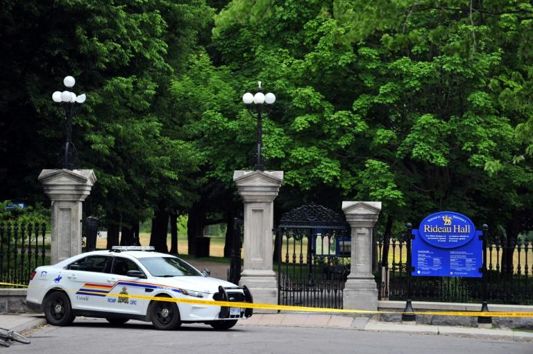 A Canadian police car is parked outside Rideau Hall, where police arrested an armed intruder on the grounds where the prime minister and the governor general reside