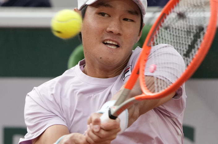Korea's Soonwoo Kwon hits return to Italy's Matteo Berrettini during their third round match on day 7, of the French Open tennis tournament at Roland Garros in Paris, France, Saturday, June 5, 2021. (AP Photo/Christophe Ena)
