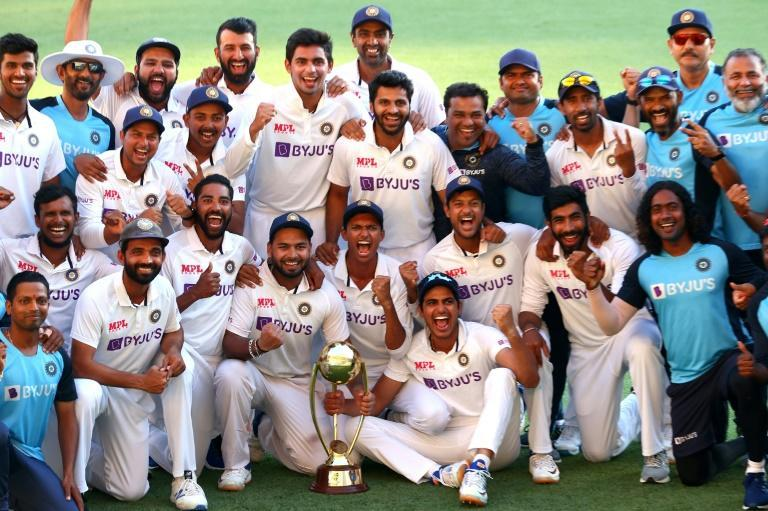 India's players celebrate with the Border-Gavaskar Trophy after their famous series-clinching win against Australia at the Gabba on Tuesday