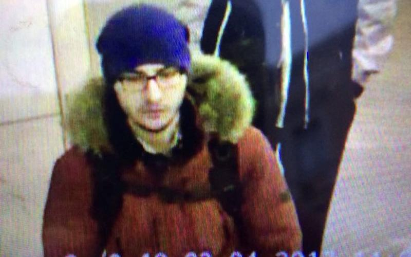Suspect Akbarzhon Jalilov walking at St Petersburg's metro station  - Credit: 5th Channel Russia/via Reuters