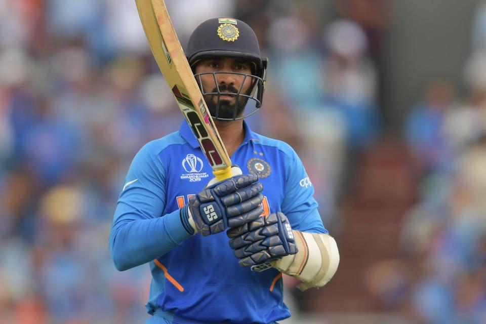 File: India's Dinesh Karthik is seen during the 2019 Cricket World Cup first semi-final between New Zealand and India at Old Trafford in Manchester, on 10 July 10 2019. Karthik was criticised for comments comparing a bat to a neighbour's wife during the England vs Sri Lanka match (AFP via Getty Images)
