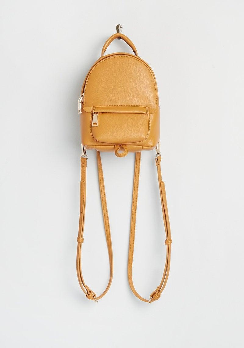 <p>The <span>Superb Adventures Mini Backpack</span> ($55) is such a chic backpack made for the one who's constantly on-the-go. It has a sturdy top handle, multiple zip compartments, and adjustable shoulder straps.</p>