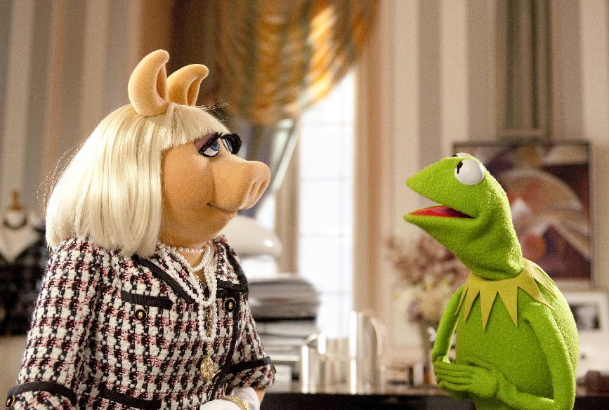 """In this undated photo provided by Disney Enterprises, Kermit the Frog, right, tries to persuade Miss Piggy to help save the Muppet Theater from being torn down in a scene from """"The Muppets,"""" opening in theaters on Nov. 23. (AP Photo/Disney, Scott Garfield)"""