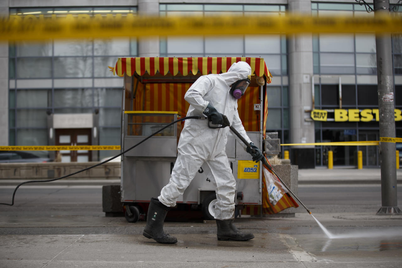 <p>A hazmat worker scrubs the sidewalk of blood and debris after a mass killing on Yonge St. at Finch Ave. on April 24, 2018 in Toronto, Canada. (Photo: Cole Burston/Getty Images) </p>