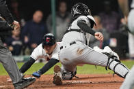 Cleveland Indians' Andres Gimenez, left, scores ahead of the tag from Chicago White Sox catcher Zack Collins in the sixth inning in the second baseball game of a doubleheader, Thursday, Sept. 23, 2021, in Cleveland. The Indians won 5-3. (AP Photo/Tony Dejak)