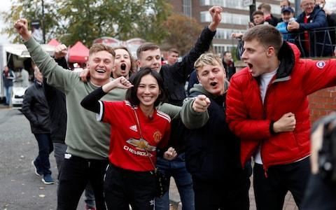 Manchester United fans outside the ground - Credit: Reuters