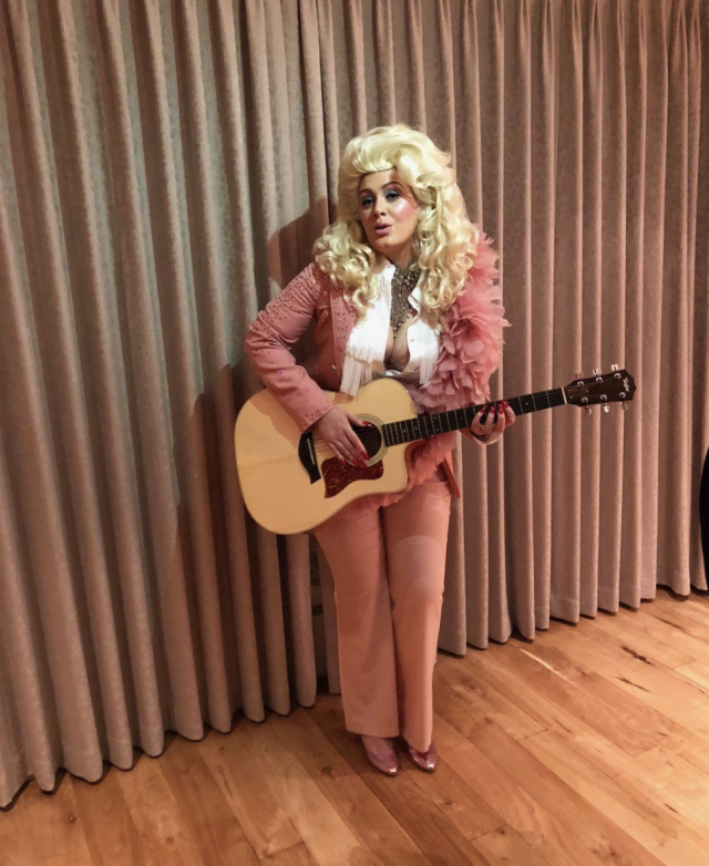 "<p>Well, hello, Dolly! The singer paid tribute to one of her idols, dressing country and completing the look with a blond wig, a guitar, and Dolly's famous ample cleavage. ""The effortless queen of song, Dolly Parton!"" she wrote. ""We love you! We wish We could possess an ounce of your ability. You were the hero of our night! A hero of my life. I'll always love you."" (Photo: <a href=""https://www.instagram.com/p/BekmeKplBZW/?taken-by=adele"" rel=""nofollow noopener"" target=""_blank"" data-ylk=""slk:Adele via Instagram"" class=""link rapid-noclick-resp"">Adele via Instagram</a>) </p>"