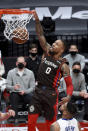 Portland Trail Blazers guard Damian Lillard dunks during the first half of the team's NBA basketball game against the Detroit Pistons in Portland, Ore., Saturday, April 10, 2021. (AP Photo/Steve Dykes)