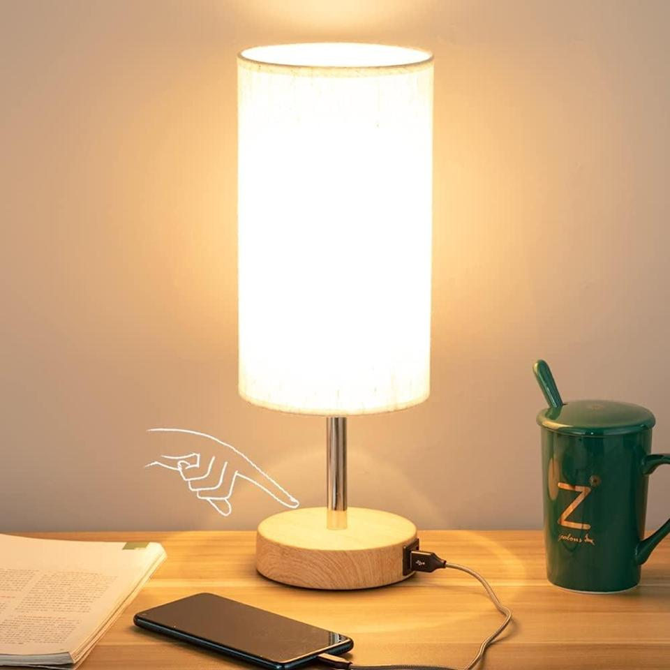 <p>This <span>Touch Control Bedside Lamp with USB port</span> ($30, originally $49) is so clever. You can use it to charge your phone, and it turns on with just a simple touch.</p>